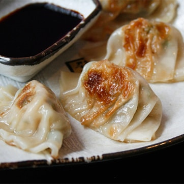 CHICKEN GYOZA WITH CABBAGE & SOYA SAUCE